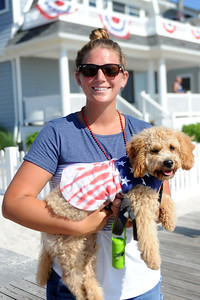 The Patriotic Bicycle Parade held on the boardwalk in Lavallette, NJ attracted several hundred participants, many who walked the course including Erin Sweeney of Lavallette with her dog Penny dressed up in Patriotic wear, on the boardwalk, in Lavallette, NJ on 07/04/2019. (STEVE WEXLER/THE OCEAN STAR).