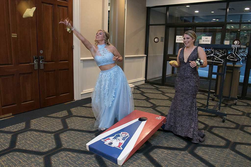 . Scenes from the Leominster High School Prom at DoubleTree by Hilton Hotel in Leominster, May 11, 2019. Playing some cornhole at the prom is Daytona-Rose Morin and Alexis Hahn. SENTINEL & ENTERPRISE/JOHN LOVE