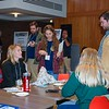 Photo of Maine AmeriCorps program members and Maine Volunteer Leadership Conference attendees in the lobby of the Donald B. Corbett Business Hall on the campus of the University of Maine in Orono.