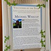 Photo of the commemorative poster created for Volunteer of the Year, Michael Wisecup.