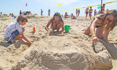 [L-R]: Jack Heyder, from Cranford; Grace Danza, from bernardsville; and Olivia Nevin, from Chatham. The 2019 Big Sea Day sandcastle contest in Manasquan, NJ on 8/10/19. [DANIELLA HEMINGHAUS]
