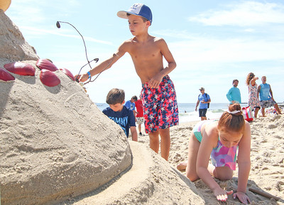 [L-R]: Patrick Priest, Shea Tracey, from Manasquan, and Gianni Spinazzola, from Manalapan. The 2019 Big Sea Day sandcastle contest in Manasquan, NJ on 8/10/19. [DANIELLA HEMINGHAUS]