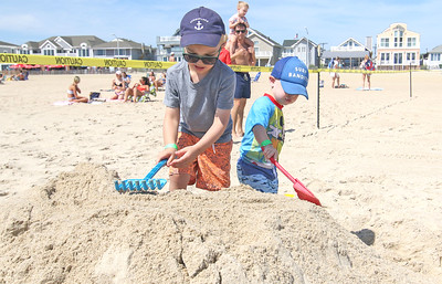 [on left]  Joey Murray and his brother Brody, from Brielle.  The 2019 Big Sea Day sandcastle contest in Manasquan, NJ on 8/10/19. [DANIELLA HEMINGHAUS]