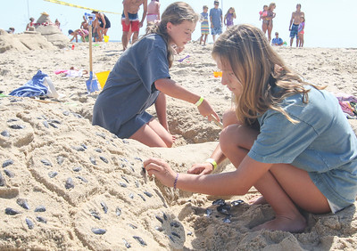 [L-R]: Katie and Emily Vaughan, from New York. The 2019 Big Sea Day sandcastle contest in Manasquan, NJ on 8/10/19. [DANIELLA HEMINGHAUS]