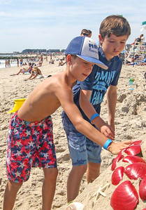 [L-R]: Shea Tracey and Patrick Priest, from Manasquan. The 2019 Big Sea Day sandcastle contest in Manasquan, NJ on 8/10/19. [DANIELLA HEMINGHAUS]
