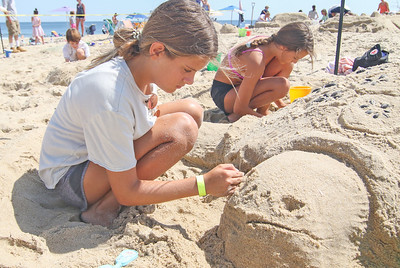 [L-R]: Emily and Oliva Adams, from Dallas TX. The 2019 Big Sea Day sandcastle contest in Manasquan, NJ on 8/10/19. [DANIELLA HEMINGHAUS]