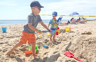 [in front] Joey Murray and his brother Brody, from Brielle.  The 2019 Big Sea Day sandcastle contest in Manasquan, NJ on 8/10/19. [DANIELLA HEMINGHAUS]
