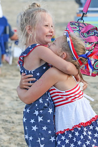 Riley Knitter hugging Molly Greener, from manasquan. Pre- Fouth of July festivities in Manasquan, NJ on 7/3/19. [DANIELLA HEMINGHAUS | THE COAST STAR]