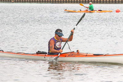 Joseph Ervin, from manasquan, in front of Adrian Patrick Carolan, from Brielle. The 2019 canoe and kayak races in Manasquan, NJ on 8/17/19. [DANIELLA HEMINGHAUS]