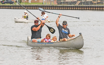 [L-R]: Mike Lozinski, from point boro; Kayla, Luca, and Tom Lozinski, from manasquan. The 2019 canoe and kayak races in Manasquan, NJ on 8/17/19. [DANIELLA HEMINGHAUS]