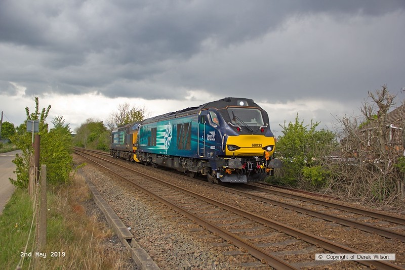 190502-028  Direct Rail Services class 68 No. 68033 with the failed 37606 in tow is captured passing Vale Road, Mansfield Woodhouse, running as 0Z38, 15:09 Shirebrook, WH Davis - Crewe Gresty Bridge. The pair were sent off-route from Shirebrook to Shireoaks for turning, which allowed time for me to change location for the return to Crewe,
