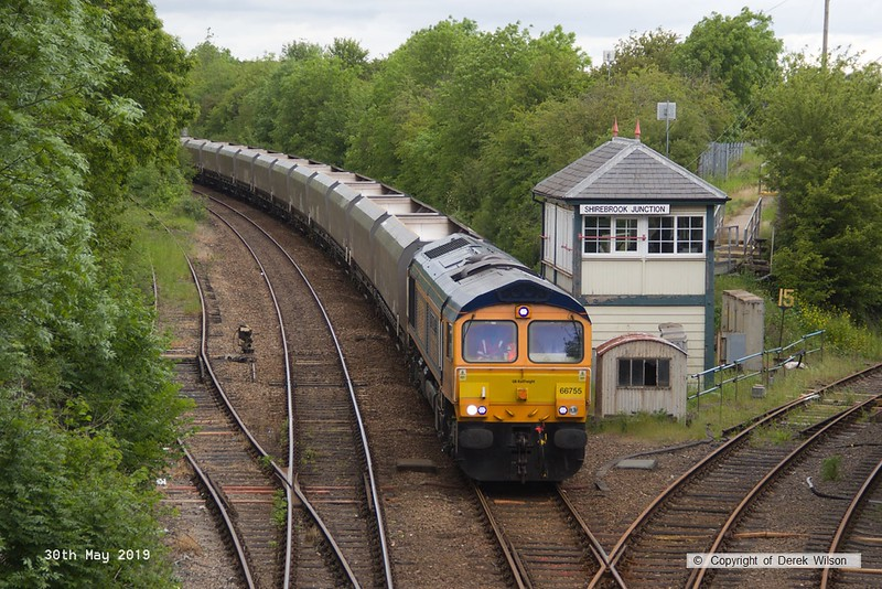 190530-0024 GB Railfreight class 66/7 No. 66755 Tony Berkeley OBE  RFG Chairman 1997 - 2018, captured passing Shirebrook Junction with a rake of redundant coal hoppers which are to be modified (cut & shut) at W.H. Davis's wagon works for use in the aggregates sector. Train 4D90, 10:45 Doncaster Down Decoy - Shirebrook, WH Davis.