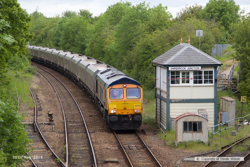 190530-002  GB Railfreight class 66/7 No. 66755 Tony Berkeley OBE  RFG Chairman 1997 - 2018, captured passing Shirebrook Junction with a rake of redundant coal hoppers which are to be modified (cut & shut) at W.H. Davis's wagon works for use in the aggregates sector. Train 4D90, 10:45 Doncaster Down Decoy - Shirebrook, WH Davis.