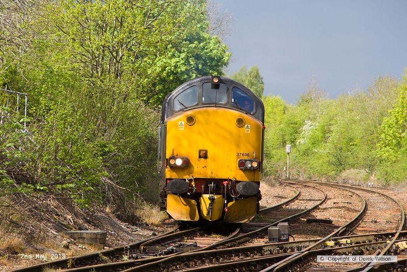 190502-022  Direct Rail Services class 37 No. 37606 is seen joining the main at Shirebrook Junction. Behind, out of sight is 68033 which rescued failed 37606 at Stafford, then brought the train forward to Davis's. The 37 was obviously powered up as it came off the branch, but something must have still been wrong as 68033 dragged it to Shireoaks, where they were turned on the triangular junction, allowing it to be towed back to Crewe.