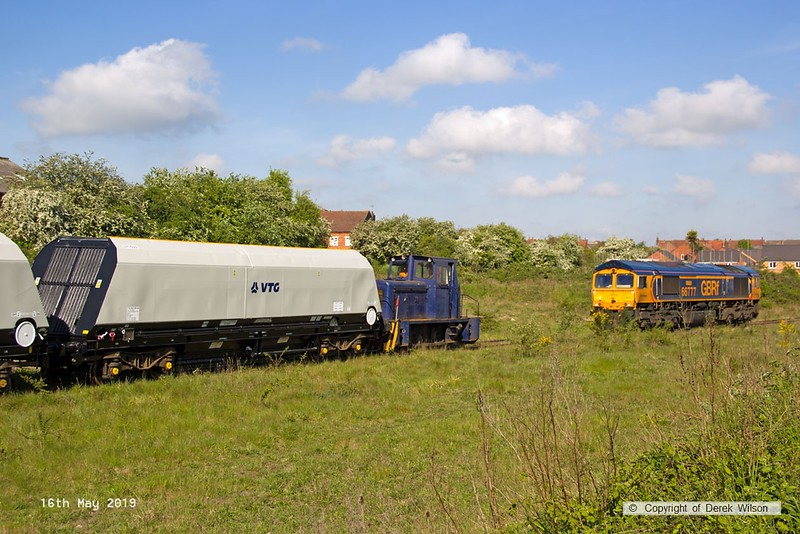 190516-015  Andrew Barclay 0-4-0DH works No. 499 is seen transferring 'cut & shut' modified bogie hoppers from Davis's wagon works to the end of the branch, for handing over to GB Railfreight. 66777 Annette is seen near the end of the siding.