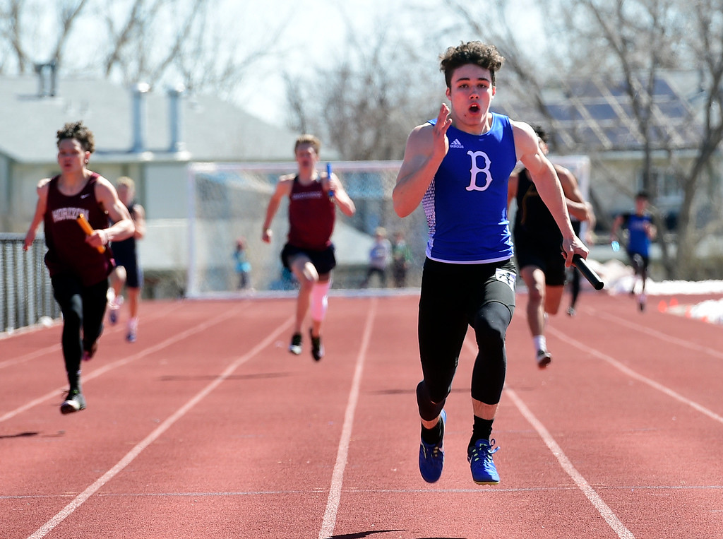 . LAFAYETTE, CO - March 16, 2019: Henry DesMarais, of Broomfield, helps his team win the 4 X 200 meters during the 2019 Monarch Coyote Warrior Invite at Centaurus High School on Saturday.  (Photo by Cliff Grassmick/Staff Photographer)