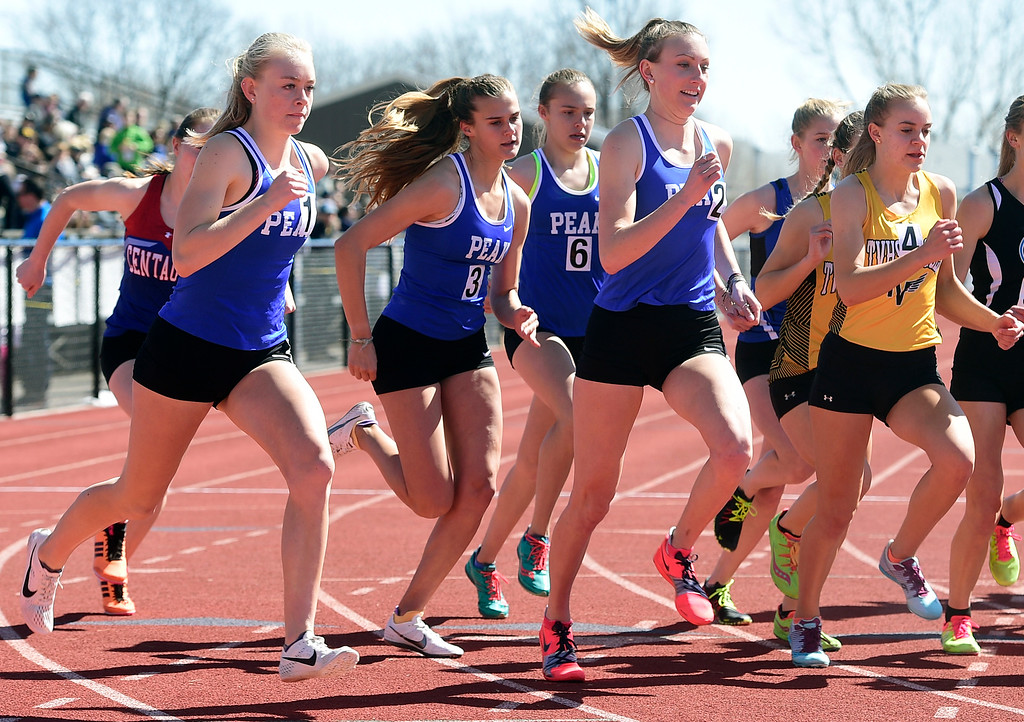 . LAFAYETTE, CO - March 16, 2019:  Anna Hults, left, Tiana Bradfield, Allison Beasley and Quinn McConnell, all of Peak to Peak, compete in the 1600 meters during the 2019 Monarch Coyote Warrior Invite at Centaurus High School on Saturday.  (Photo by Cliff Grassmick/Staff Photographer)