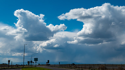 Sun, blue sky, clouds, rain and all at the same time. Highway 90 near Mosses Lake Washington.
