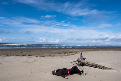 Mark takes a bread to gaze at the clouds...or take a nap at Grayland Beach, Wa