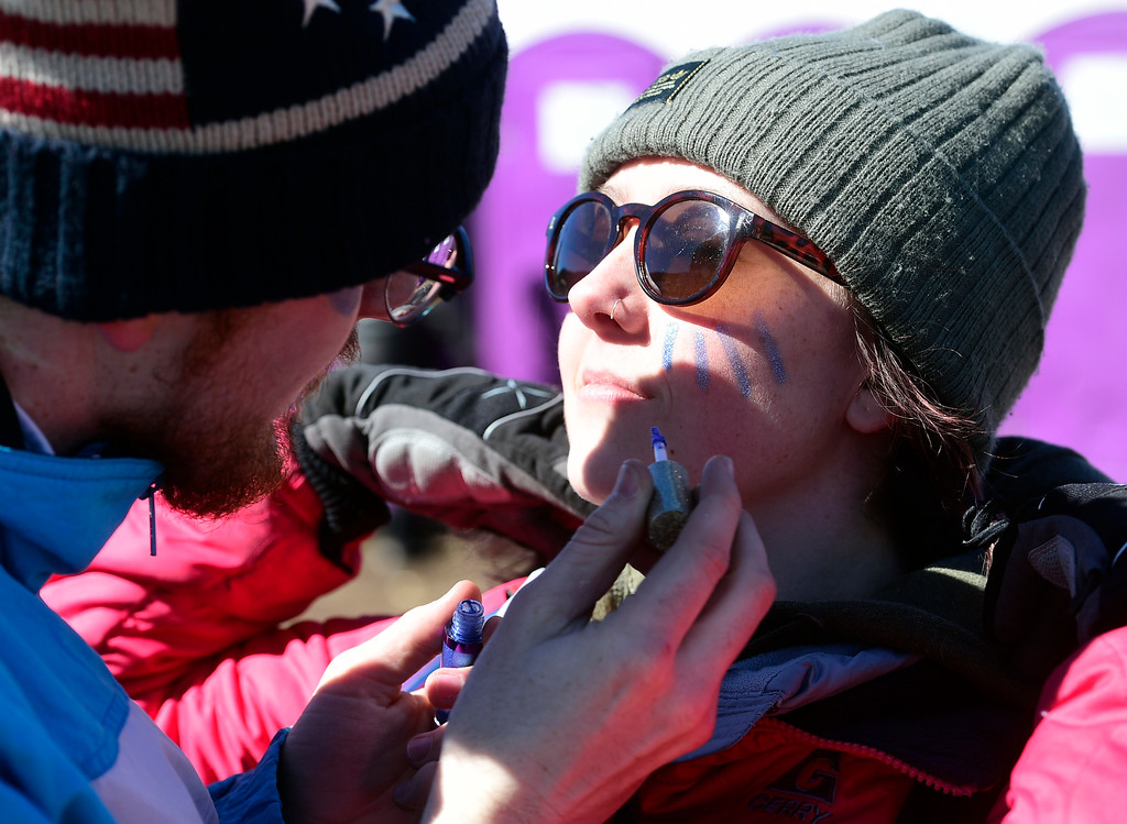 . NEDERLAND, CO: March 9, 2019:Adam Rubin paints the face of Rylee McCone during Nederland\'s 18th annual Frozen Dead Guy Days on Saturday. (Photo by Cliff Grassmick/Staff Photographer)