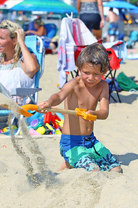 Kai Raiczer,age 6 of Belmar shovels out sand as he starts work on his sand sculpture during the 33rd annual New Jersey Sandcastle Contest was held at the 18th Ave beach in Belmar on Wednesday July 17, 2019. (MARK R. SULLiVAN/ THE COAST STAR)