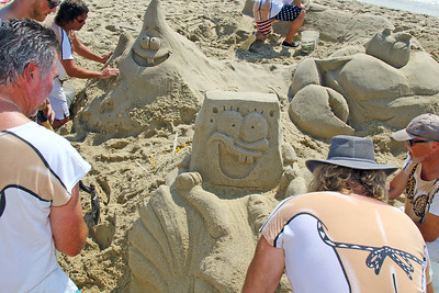 Members of the Bikini Boys work on their SpongeBob Square Pants sculpture during the 33rd annual New Jersey Sandcastle Contest was held at the 18th Ave beach in Belmar on Wednesday July 17, 2019. (MARK R. SULLiVAN/ THE COAST STAR)