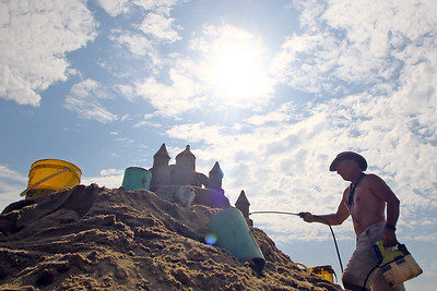 Matthew Deibert from Sandcreation work on his sand sculpture during the 33rd annual New Jersey Sandcastle Contest was held at the 18th Ave beach in Belmar on Wednesday July 17, 2019. (MARK R. SULLiVAN/ THE COAST STAR)