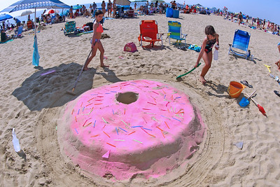 Maggie Goodwin and Keira Donnelly of Glen Ridge work on their donut sand sculpture during the 33rd annual New Jersey Sandcastle Contest was held at the 18th Ave beach in Belmar on Wednesday July 17, 2019. (MARK R. SULLiVAN/ THE COAST STAR)