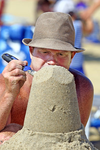 Micheal Perry of Long Branch works on his sculpture during the 33rd annual New Jersey Sandcastle Contest was held at the 18th Ave beach in Belmar on Wednesday July 17, 2019. (MARK R. SULLiVAN/ THE COAST STAR)