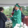 AIMEE AMBROSE | THE GOSHEN NEWS <br /> Carlos Escalante receives his diploma during Northridge High School's graduation ceremony in Middlebury Sunday.