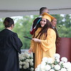 AIMEE AMBROSE | THE GOSHEN NEWS <br /> Martha Contreras receives her diploma during Northridge High School's graduation ceremony in Middlebury Sunday.