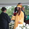 AIMEE AMBROSE | THE GOSHEN NEWS <br /> Chloe Baxter receives her diploma during Northridge High School's graduation ceremony in Middlebury Sunday.