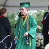 AIMEE AMBROSE | THE GOSHEN NEWS <br /> Alexander Donahoe walks from the stage after receiving his diploma during Northridge High School's graduation ceremony in Middlebury Sunday.