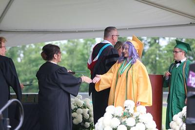 AIMEE AMBROSE | THE GOSHEN NEWS  Dayanna Gomez Gonzalez receives her diploma during Northridge High School's graduation ceremony in Middlebury Sunday.