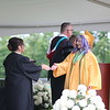 AIMEE AMBROSE | THE GOSHEN NEWS <br /> Dayanna Gomez Gonzalez receives her diploma during Northridge High School's graduation ceremony in Middlebury Sunday.