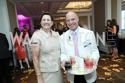 Co-Chair Janet Davis, Jim Underhill. Photo by Tony Powell. 14th Annual Women & Wine. Ritz Tysons. April 24, 2019