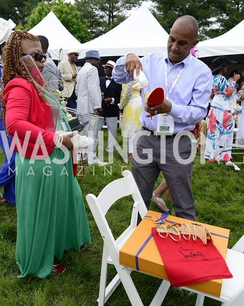 Returning the shoes in protective case, DC09 Party at the 2019 Gold Cup, Great Meadow, May 4, 2019, photo by Nancy Milburn Kleck