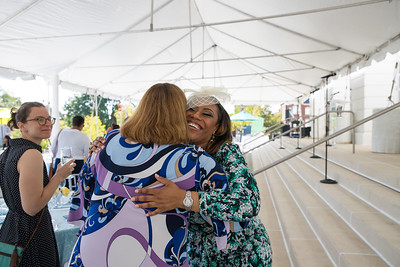 Dr. Kristy Arnold hugs friend. photo by Bruce Allen. LIFT Jazz Brunch