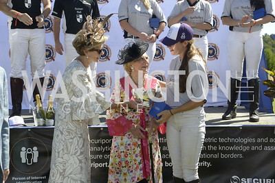 TTR Sotheby's Player Isabella Wolf receiving MVP from Jacqueline Mars (center), NSLM 2019 Polo Classic Great Meadow Sep 15 2019 Photo by Nancy Milburn Kleck