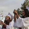 Elizabeth Anzelone (left) and Grace Rosendin (right) celebrate graduation during the traditional walk-in at Om Wraith Field. The class of 2019 was able to graduate on Om Wraith Field, nearly seven months after the Camp Fire. Rick Silva -- Paradise Post