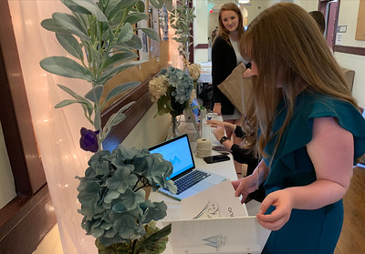 Communications Studies Senior Michaela Killon setting up for the Senior Show that takes place each semester to showcase the seniors work they created over their 4 years at GWU.