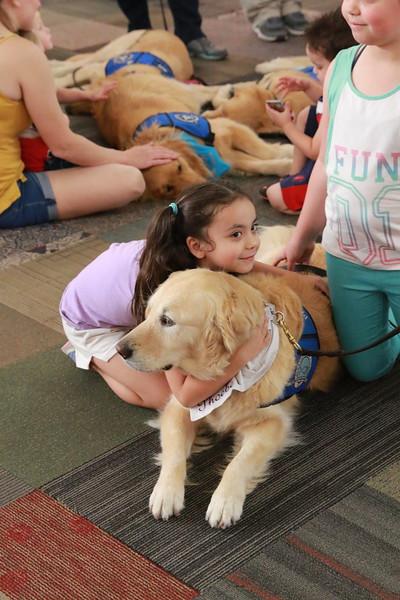 Phoebe Comfort Dog Getting a Hug at Music City Mall