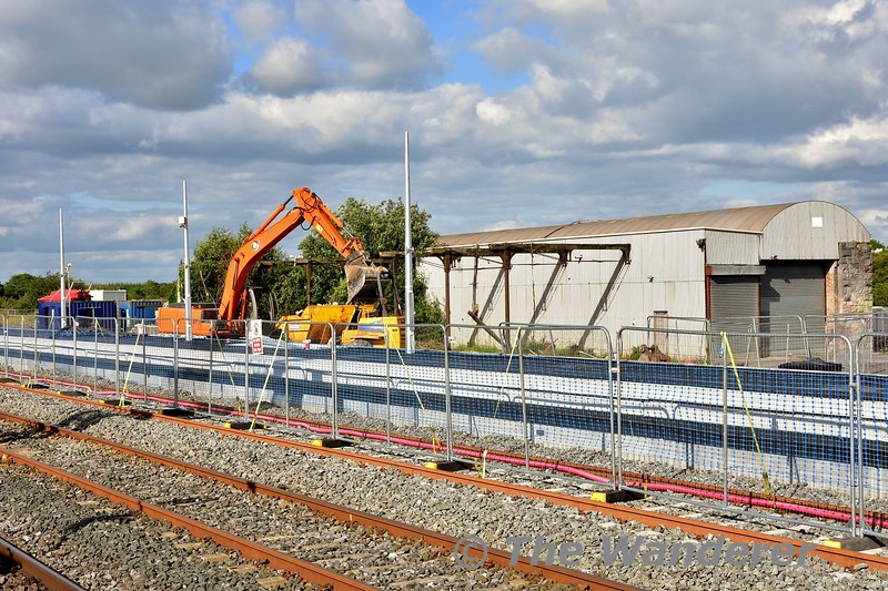 The reason for 728 being moved, the loco shed has been demolished. Here we see a digger clearing away the rubble. Mon 01.07.19