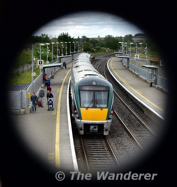 """Viewed through the footbridge we see 22042 leaving Portarlington with the 1505 Galway - Heuston. The train would be delayed for 60 minutes at Kildare as the emergency services dealt with an medical emergency onboard after a lady went into labour. We hope the mother and newborn baby girl are doing well. Tues 11.06.19 <br><br> <a href=""""https://www.independent.ie/irish-news/news/its-a-girl-woman-gives-birth-on-packed-commuter-train-from-galway-to-dublin-this-evening-38210337.html/"""" target=""""_blank"""">Click here </a> for the full story in the Irish Independent."""