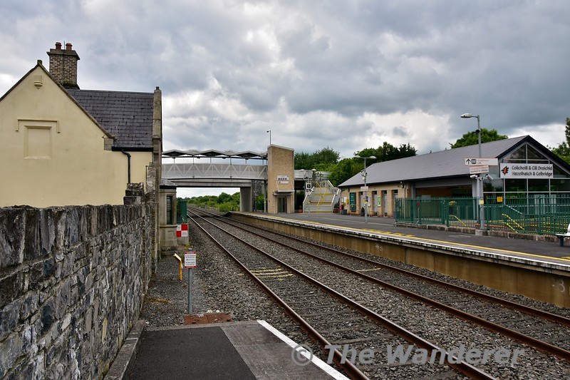 A view of Hazelhatch Station. The building to the left is the former station building which is now marooned on the island platform between the Up and Down Slow lines. On the right is the new modern building which was built when the station was reconstructed for the 4 tracking. Tues 11.06.19