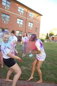 Girls from Stroup invite all others to come have a fun time with color powders and to create a collective community.