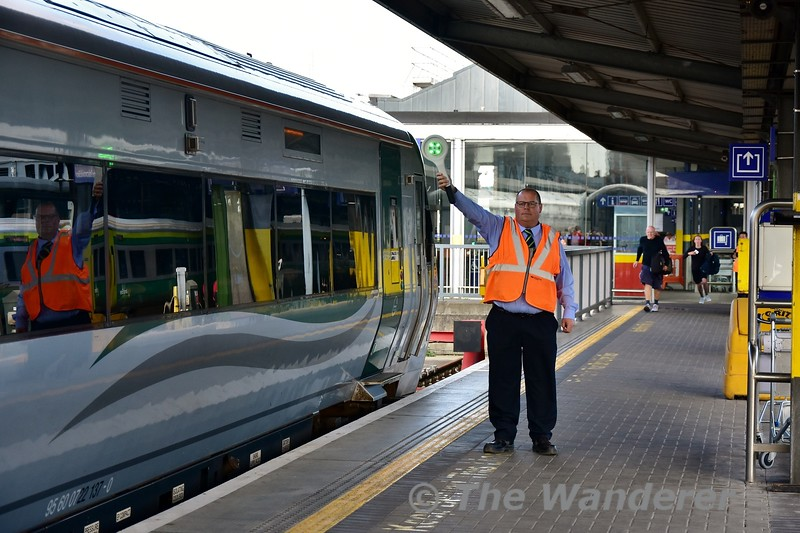 Heuston Station Controller Stephen Dowdall gives the right away to the driver of the 1625 Heuston - Limerick. In the backround two late passengers have just missed the train.Thurs 05.09.19