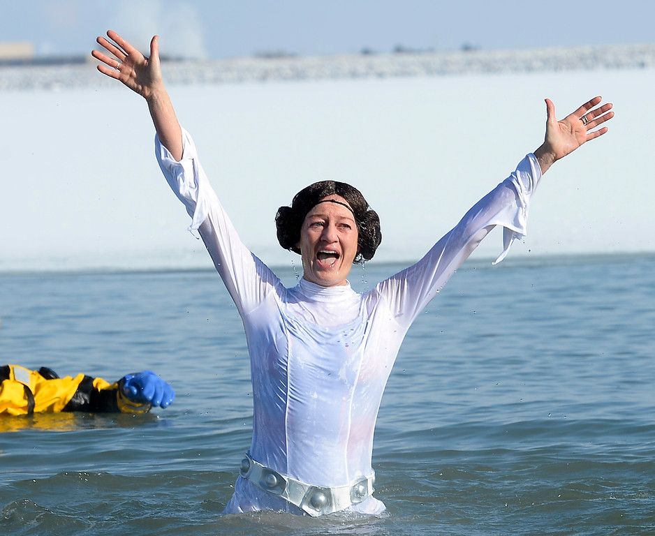 ". BOULDER, CO - January 1, 2019: Shawna Kinkead, of the ""Don\'t Call me a Princess!\""   team, show their plunging experience during  the annual Polar Plunge at the Boulder Reservoir on January 1, 2019. For a video and photos, go to dailycamera.com.  (Photo by Cliff Grassmick/Staff Photographer)"