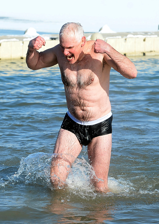. BOULDER, CO - January 1, 2019: Andrew Butrell can flex after competing  the annual Polar Plunge at the Boulder Reservoir on January 1, 2019. For a video and photos, go to dailycamera.com.  (Photo by Cliff Grassmick/Staff Photographer)