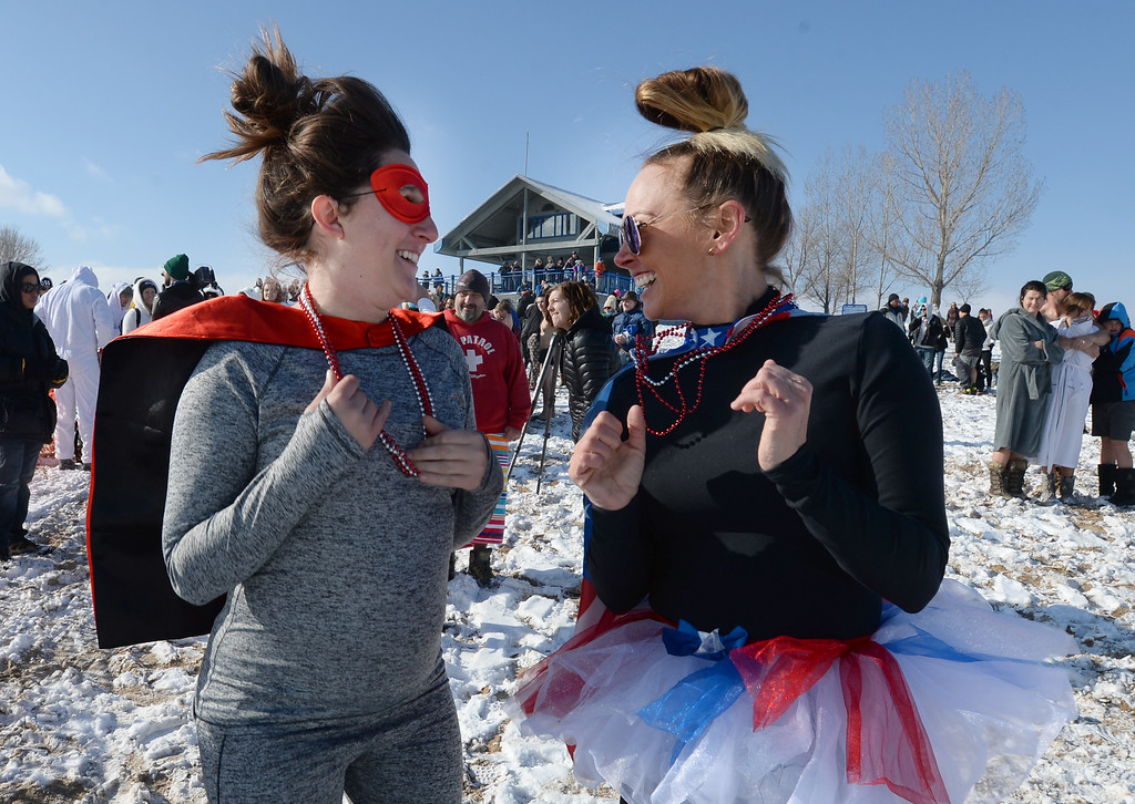 . BOULDER, CO - January 1, 2019:  Shiloh May, left, and Sara Lister, ask themselves if they should plunge or not during  the annual Polar Plunge at the Boulder Reservoir on January 1, 2019. For a video and photos, go to dailycamera.com.  (Photo by Cliff Grassmick/Staff Photographer)